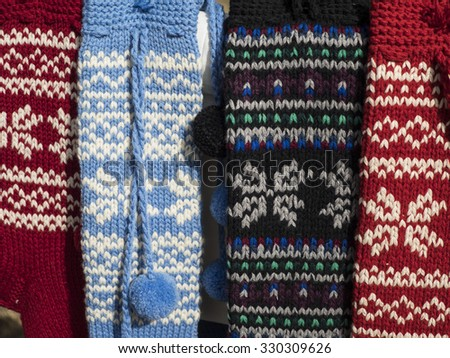 Multi-colored woolen socks with a tradition of pattern - stock photo
