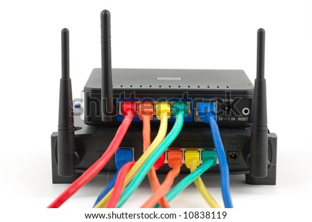 Multi colors cables connected to wireless routers over white - stock photo