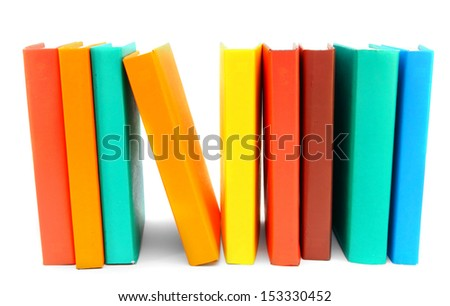 multi-coloured books on a white background. - stock photo