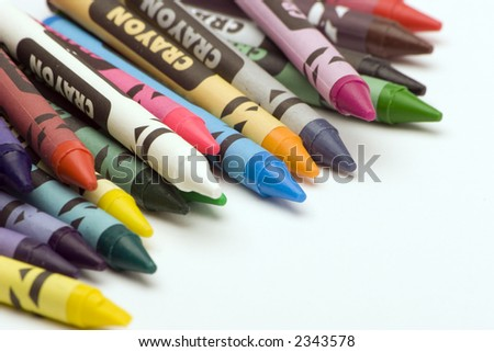 Multi Coloured Crayons set against a plain background.