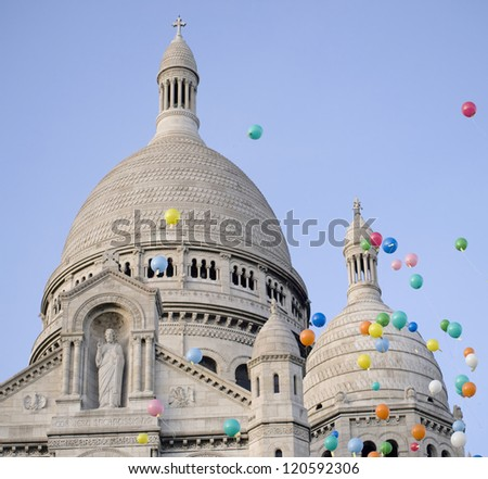 Multi Coloured helium balloons in front of the Sacre Coeur basilica in Montmartre (Paris, France).