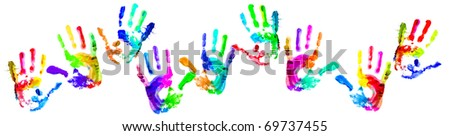 Multi coloured painted handprints arranged in the form of snakes on a white background. - stock photo