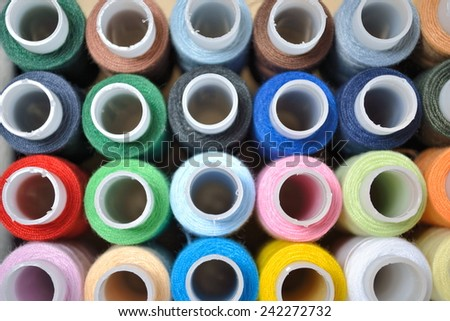 Multi-coloured threads for embroidery - stock photo