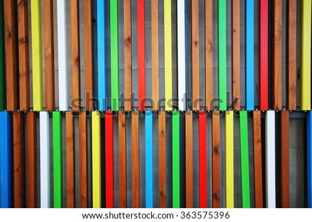 Multi-coloured wooden cladding for a building.