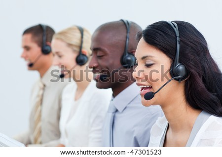 Multi-cultural business people working in a call center in the office - stock photo