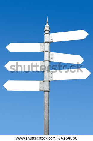Multi-directional six way signpost with blank spaces for text. - stock photo