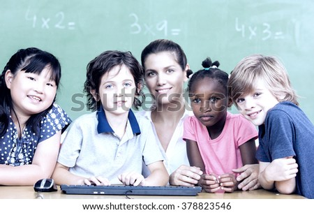 Multi ethic primary school classroom with teacher. Group of five people - stock photo