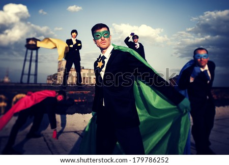 Multi-ethnic and Diverse Superhero Businessmen on Rooftop - stock photo