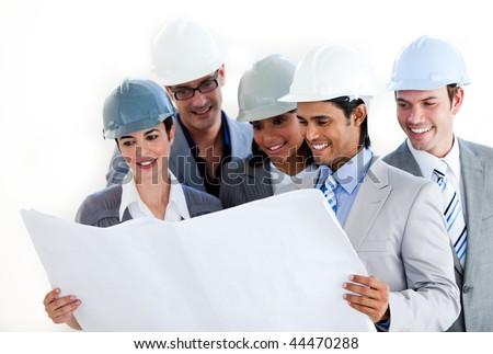 Multi-ethnic architects studying a blueprint against a white background - stock photo
