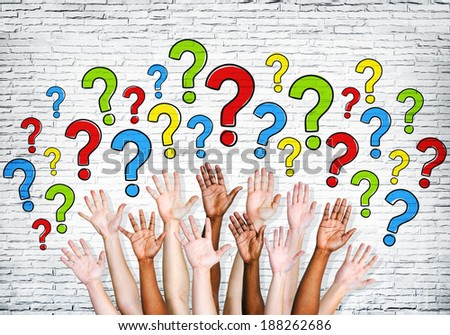Multi-ethnic arms outstretched to ask questions. - stock photo