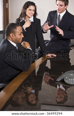 Multi-ethnic business meeting in boardroom - stock photo