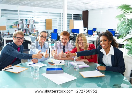 Multi ethnic business meeting thumbs up gesture happy smiling teamwork - stock photo