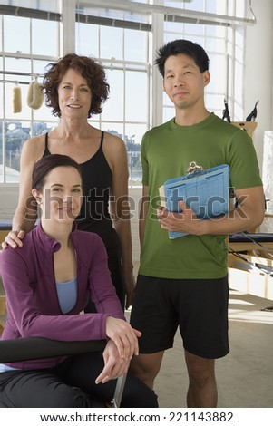 Multi-ethnic business owners in exercise studio - stock photo