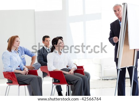 Multi-ethnic business people at a seminar in the office - stock photo