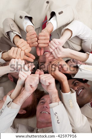 Multi-ethnic business people with thumbs up lying on the floor. Concept of success. - stock photo