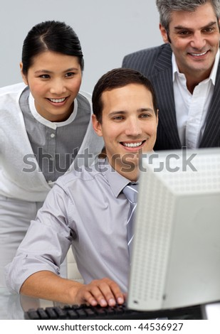 Multi-ethnic business people working together at a computer