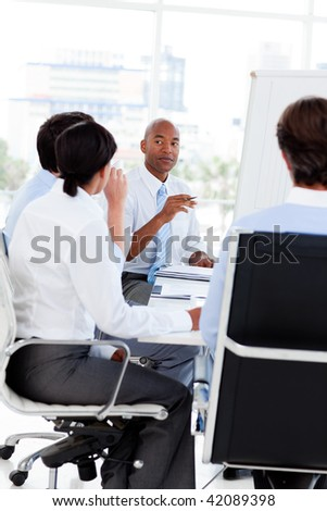 Multi-ethnic business team at a meeting in the office - stock photo