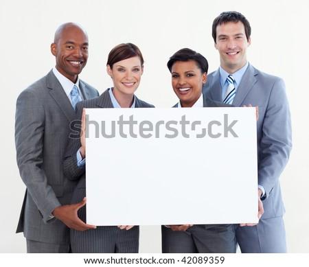 Multi-ethnic business team holding white card isolated on white background - stock photo