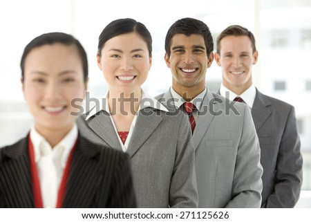 Multi ethnic business team. People standing in a row
