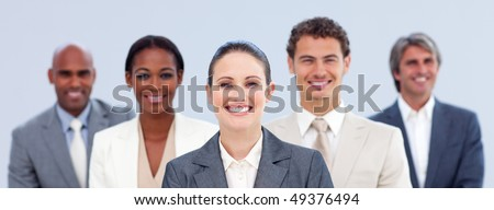 Multi-ethnic business team standing looking at the camera