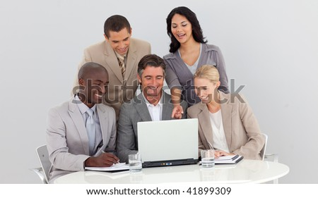 Multi-ethnic business team studying sales figures in the office - stock photo
