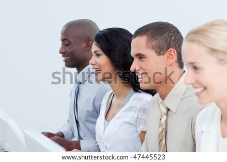 Multi-ethnic business team working in the office in a company
