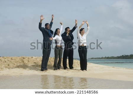Multi-ethnic businesspeople waving at beach - stock photo