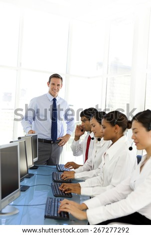 Multi ethnic Call Center team with manager