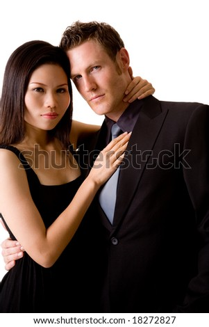 multi-ethnic couple dress in smart black dress and suit