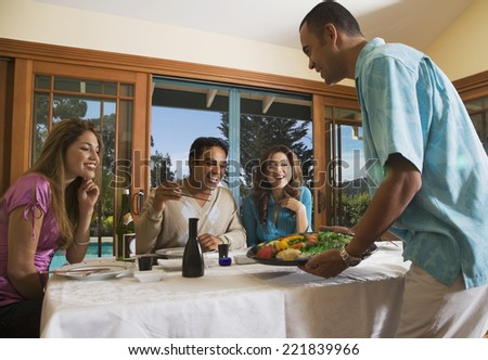 Multi-ethnic couples eating sushi - stock photo