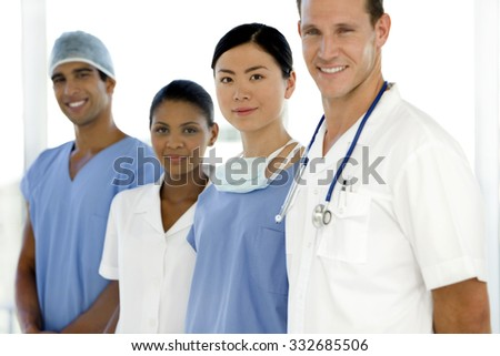 Multi ethnic doctors and nurse standing in a row - stock photo
