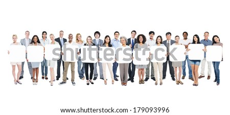 Multi-Ethnic Group Of Business And Casual People Holding 12 Empty Cardboards