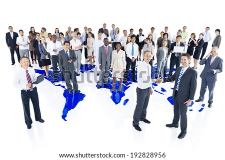 Multi-ethnic group of business people with world map - stock photo