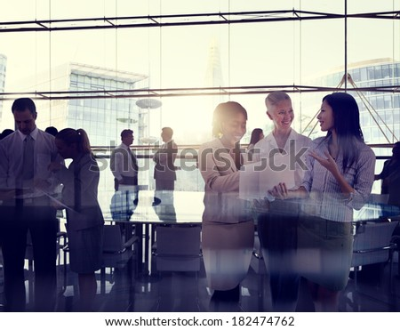 Multi-Ethnic Group Of Business People Working In A Board Room - stock photo