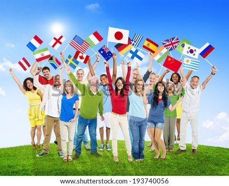 Multi-Ethnic Group of People Holding National Flags Outdoors - stock photo