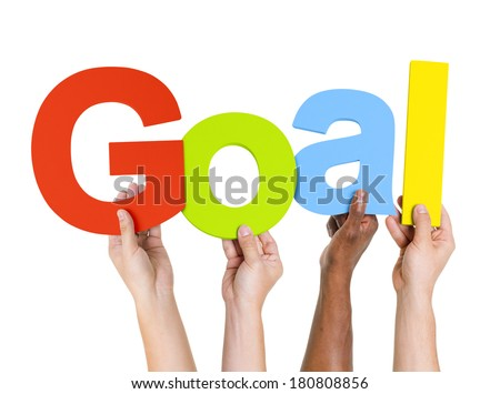 Multi-Ethnic Group Of People Holding The Word Goal - stock photo