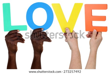 Multi ethnic group of people holding the word love isolated - stock photo