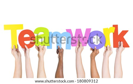 Multi-Ethnic Group Of People Holding The Word Teamwork - stock photo