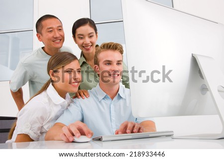 Multi ethnic group of people looking computer - stock photo