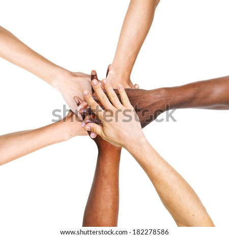 Multi-Ethnic Group Of People Stacking Their Hands Together - stock photo