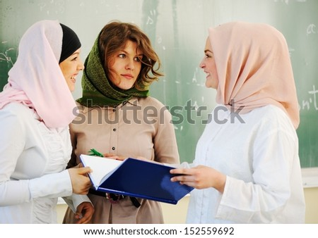 Multi ethnic group of teenage students inside the high school classroom posing on board - stock photo