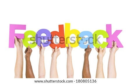 Multi Ethnic People Holding The Word Feedback - stock photo