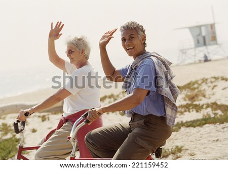 Multi-ethnic senior women riding bicycles - stock photo