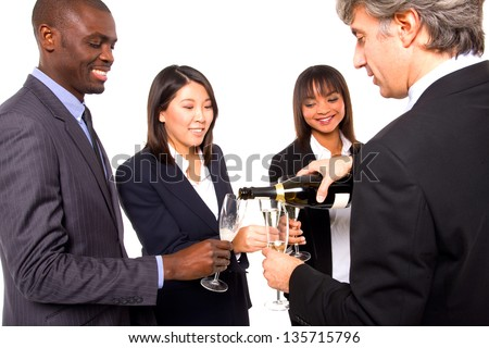 multi-ethnic team toasting