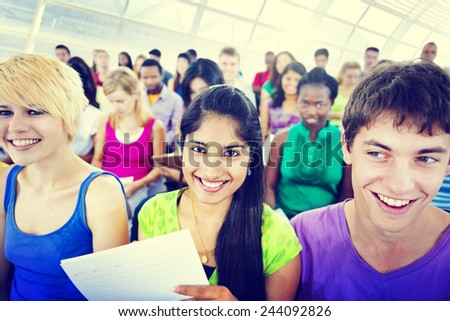 Multi-ethnic young people in lecture room - stock photo