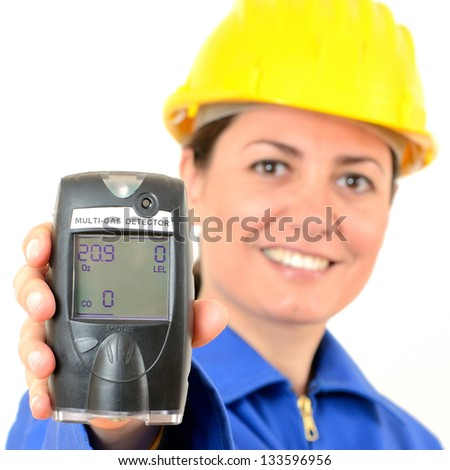 Multi-gas detector, a device for measuring the concentration of explosive gases. A handheld engineer - stock photo