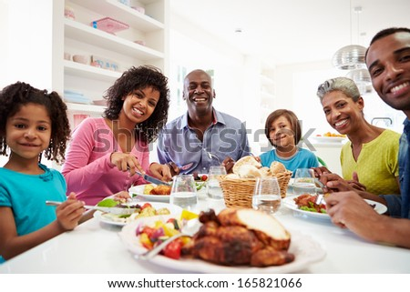 Multi Generation African American Family Eating Meal At Home - stock photo