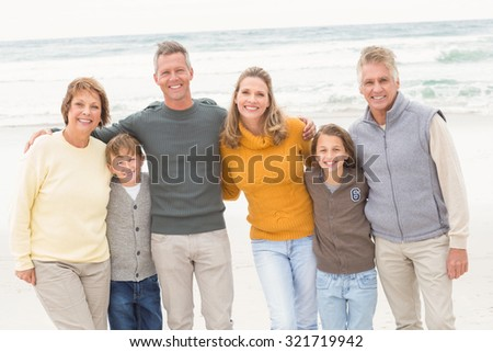 Multi generation family all together at the beach - stock photo