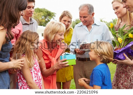 Multi Generation Family Celebrating Birthday In Garden - stock photo