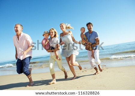Multi Generation Family Enjoying Beach Holiday - stock photo